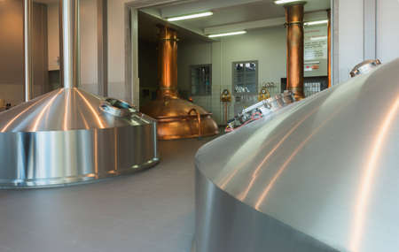 BAVIKHOVE, BELGIUM - CIRCA MARCH 2014  four of the five brew vessels in the brew house of Brewery De Brabandere  Editorial