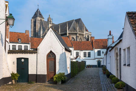 beguin: Kortrijk Beguinage and the Notre Dame Church nearby, Flanders, Belgium
