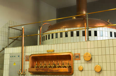 brew house: Mash tun and wort siphoning valves in Brewery De brabandere, Bavikhove, Belgium  Editorial