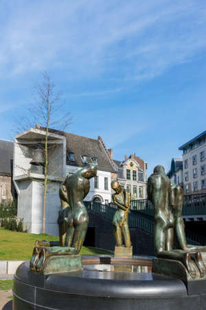 GENT, BELGIUM - CIRCA MARCH 2014: Spring of the Bereaved. Statue of five naked men, made by George Minne and placed in Gent in 1937. The five young men look at their reflection in the water of the statue just like Narcissus.