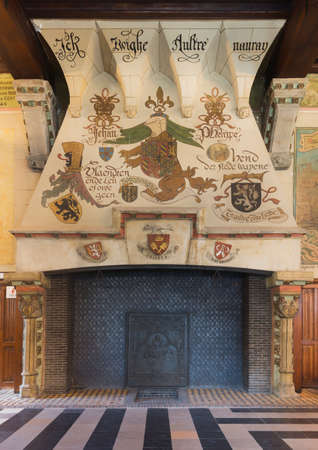 GENT, BELGIUM - CIRCA MARCH 2014: Fireplace inside Ghent Belfry, Belgium. Old Flemish slogans appear together with coat of arms of the Duke of Flanders.