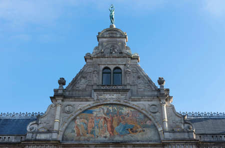 Fresco, painting, and top of historic Ghent Theater facade