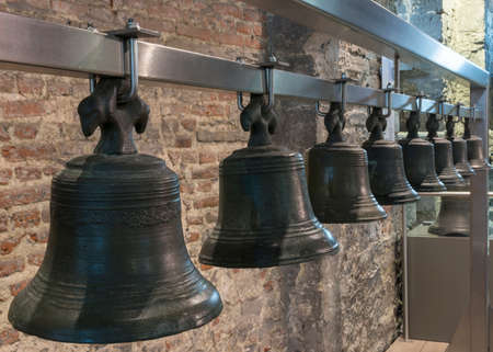 Collection of historic bells hang in Ghent Belfry, Belgium, form a line