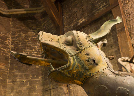 gulden: Head of the previous, giant Gulden Draak statue on display inside Ghent Belfry  The golden dragon statue on top of the Belfry needs to be replaced every thirty years