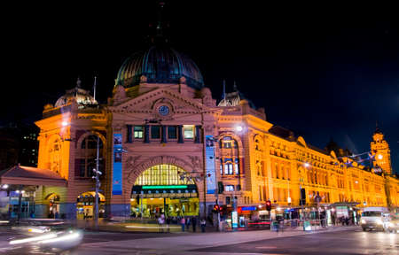 MELBOURNE, AUSTRALIA - CIRCA NOVEMBER 2009  Front of Flinders railway station at night, with passing cars and people