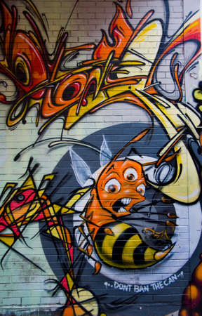 MELBOURNE, AUSTRALIA - CIRCA NOVEMBER 2009  Colorful graffiti in back alley of downtown, depicts a bunch of scary looking figures and a three-eyed angry honey bee