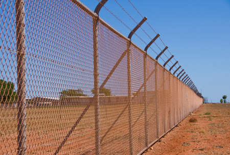 barbed wire fence: Nasty Fence at the naval base in Exmouth, Australia