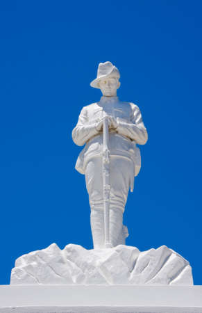 Memorial for Australian soldier in Bunburry town, Australia, featuring in all white marble a solemnly standing soldier leaning on his rifle  Editorial