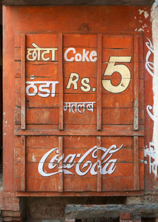 BITHOOR, INDIA - CIRCA MARCH 2011  Boarded up little shop with Coca-Cola advertisement  Editorial