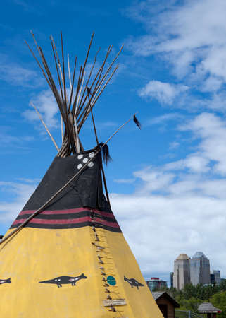 CALGARY, CANADA - CIRCA JULY 2011  Indian tipi with city skiline in background