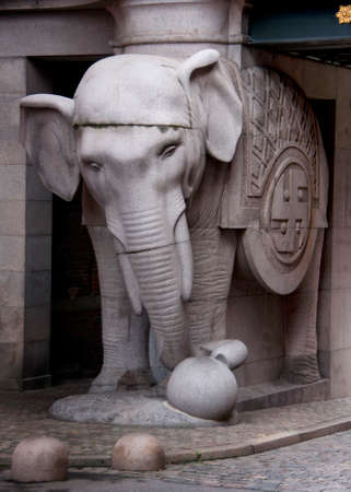 carlsberg: COPENHAGEN, DENMARK - CIRCA SEPTEMBER 2010: One of the two elephants of the monumental gate at Carlsberg brewery. The Hindu swastika symbol is featured on the side of the animal. Editorial