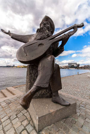 willy: STOCKHOLM, SWEDEN - CIRCA SEPTEMBER 2010: Statue of Evert Taube, Swedish Troubadour (1890-1976). Sculpted by Willy Gordon in 1990.