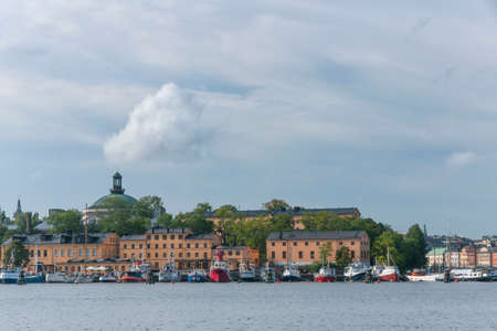 STOCKHOLM, SWEDEN - CIRCA SEPTEMBER 2010: Skeppsholmen as seen from Djurgarden. The waterfront, the vessels and the museum building.