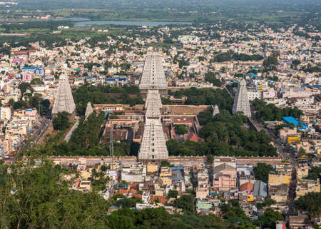 THIRUVANNAMALAI, INDIA - CIRCA OCTOBER 2013: Shot from the holy mountain covering the temple.