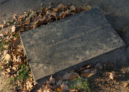 Tombstone for four unknown German soldiers at the WW I war cemetery in Langemark, Belgium. Editorial