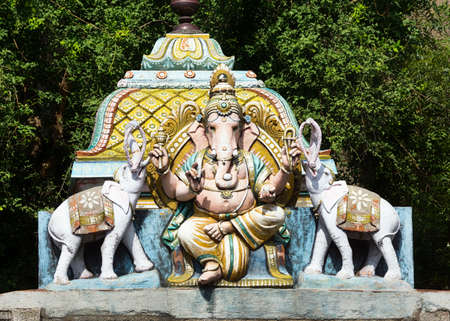 Lord Ganesha flanked by two elephants. Seen at Thiruvannamalai Shiva temple on top of a small shrine.