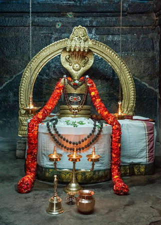THIRUVANNAMALAI, INDIA - OCTOBER 10, 2013: The Niruthi Shiva Lingam stands in its shrine at the base on the south side of the holy mountain. Editorial