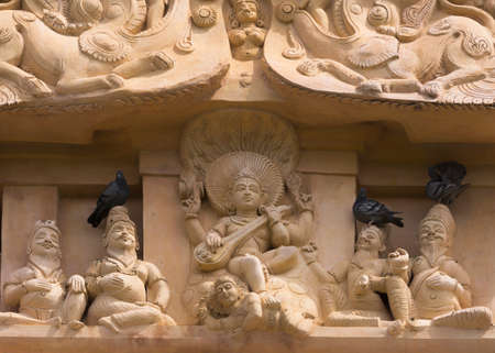 conquers: Statue on the tower of the Gangaikunda Temple. Lord Shiva conquers ignorance. He is the supreme teacher. His foot rests on the ignorance demon. Gurus are listening to him.