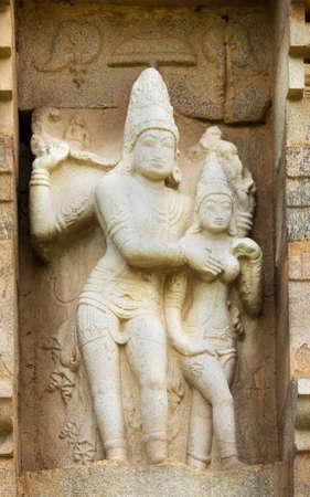 devi: KUMBAKONAM, INDIA - OCTOBER 11, 2013: Lord Shiva and Devi Parvati statue on the outside wall of the Gangaikunda Temple. Stock Photo