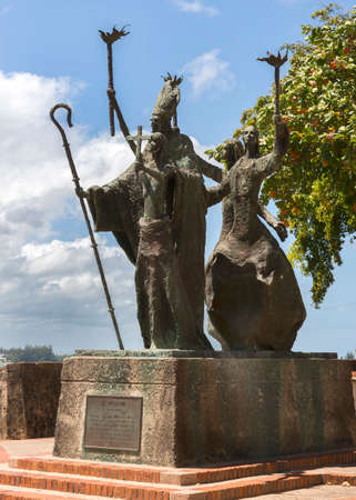 SAN JUAN, PUERTO RICO - MARCH 8, 2015: La Rogativa Statue by Lindsay Daen stands on the city walls, bay side. Rogativa is a Spanish word that derives from the verb %u201Crogar%u201D meaning to plea or supplicate.  Editorial