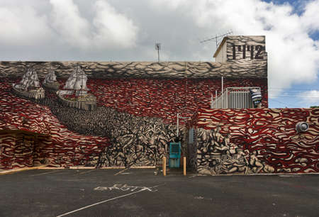 conquistador: SAN JUAN, PUERTO RICO - MARCH 13, 2015: Graffiti in Tras Talleres neighborhood. Very sharp image of the three ships of Christopher Columbus arriving in the Americas and surrounded by a sea of blood, corpses and death in general. The year 1492 is mentioned