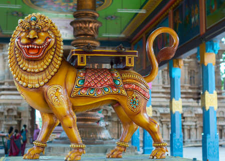 however: KUMBAKONAM, INDIA - OCTOBER 12, 2013: Mahalingeswarar Temple. An open-sided hall or walkway leads to the inner sanctum. Statue of lion, which is the goddess Durga in her Sakthi appearance. the divine feminine creative power. However, the fierce looking an