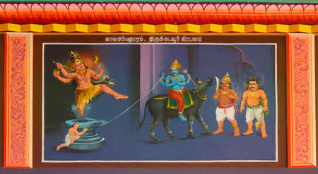 KUMBAKONAM, INDIA - OCTOBER 12, 2013: Mahalingeswarar Temple. Painting on the ceiling of the open hall, Mandapam to the inner sanctum. Shiva saves the life of Markandeya and kills Death, personified as Yama. However, Shiva restored Yama's life in compen Editorial