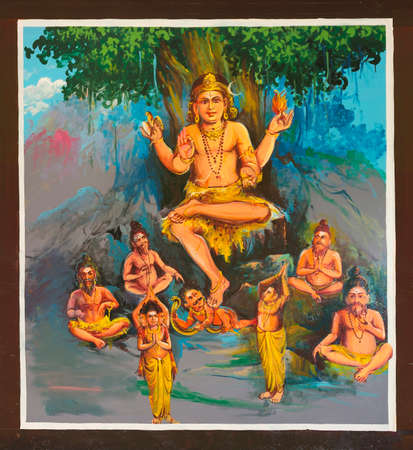 KUMBAKONAM, INDIA - OCTOBER 12, 2013: Mahalingeswarar Temple. Painting on the ceiling of the open hall, walkway to the inner sanctum. Dhakshinamoorthy. Lord Shiva as the teacher conquering ignorance, symbolized as the dwarf, Apasmara, under his foot. Very