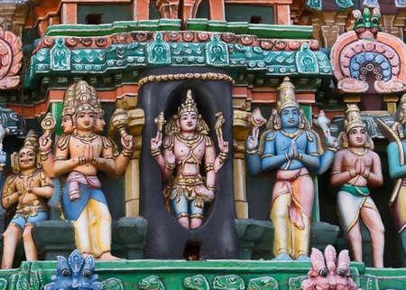 parvati: KUMBAKONAM, INDIA - OCTOBER 13, 2013: Kumbeswarar Temple Gopuram. Lingothbawar, Shiva popping out of the Shivalingam. To his left is the three headed Brahma, and to his right is the blue Vishnu. Editorial