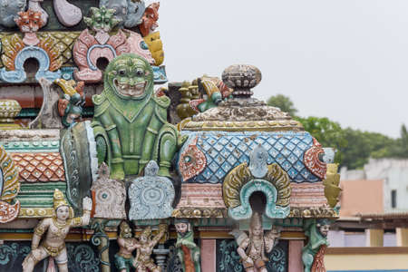 sea monster: Trichy, India - October 15, 2013: Closeup of  green monster statue on Gopuram at Shrirangam temple. Often associated with Makara, the Hindu sea monster. The beast guards sanctuaries and is associated with Vishnu. Editorial