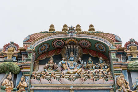 vishnu: Trichy, India - October 15, 2013: Closeup of a statue scenery at Ranganathar Temple showing Lord Vishnu and his harem: Lakshmi to his right, and Devi Bhu and Neela. Shesha the snake makes a throne for the group. Editorial