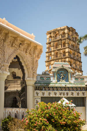 nataraja: Thanjavur, India - October 14, 2013: Combination shot of the Bell Tower and other halls and buildings of the Palace of Thanjavur. Part of the courtyard and the Nataraja image of Lord Shiva.