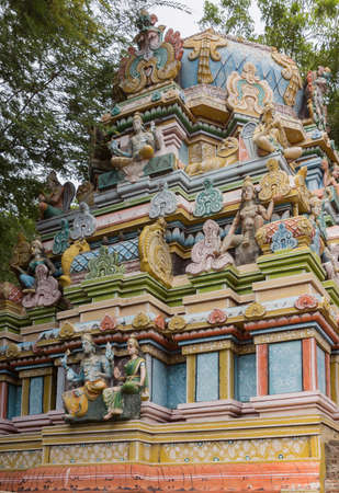 temple tower: Trichy, India - October 15, 2013: Facade of short Vimanam at Ranganathar Temple. Tower stands on top of old part built during Madurai Nayak era. Statue of Lord Vishnu and his wife upfront. He holds his discuss and conch.
