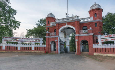 deposed: Chettinad, India - October 15, 2013: British style, red gate to Old mansion of the deposed maharajah. This is now the government building that houses the local tax collectors. Pudukkottai. Editorial