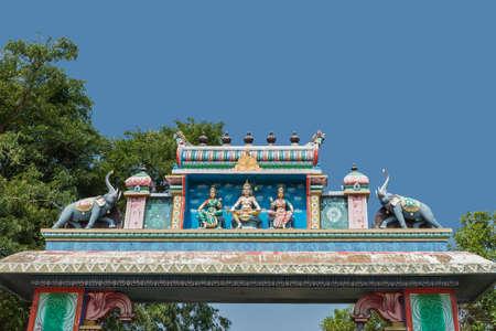 devotions: Chettinad, India - October 16, 2013: Ayyanar, village protector Horse shrine of Namunasamudran. Entrance gate features Lord Murugan and his wives.