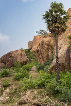 bulwark: Chettinad, India - October 16, 2013: View from outside the Thirumayam fort on a corner of the fortifications. Boulders and trees in foreground. Editorial