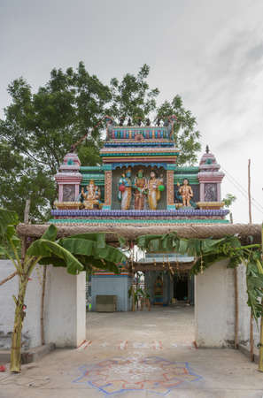 he   my sister: Chettinad, India - October 17, 2013: Entrance to the shrine of Shani, known as Satan in the West, in Kadiapatti. Image features wedding of Shiva and Parvati. The blue skinned person is Lord Vishnu. He gives his sister, the green-skinned female in the midd