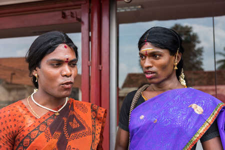 transsexual: Chettinad, India - October 17, 2013: Portrait of Ms. Abinaja and Ms. Sheila, both Hijras, transgender persons. Hijras are males who dresses and acts like a woman. Have a sacred status in Hinduism. Dark, open faces, saris and jewelry. Karaikudi city. Editorial