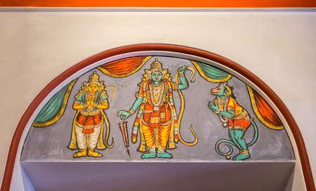 vishnu: Chettinad, India - October 17, 2013: Chidambara Palace in Kadiapatti. Wall painting above door showing Vishnu as Rama, Hamuman and Lakshmana. Editorial