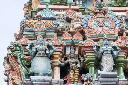 vishnu: Madurai, India - October 19, 2013: Closeup of two avatars of Lord Vishnu, the fish and the turtle. Statues on facade of West Gopuram at Meenakshi Temple.