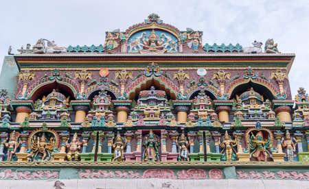 nagara: Facade at Nagara Mandapam showing Lakshmi and her two elephants together with a row of gods, including Meenakshi, Ganesha, Kali, Murugan