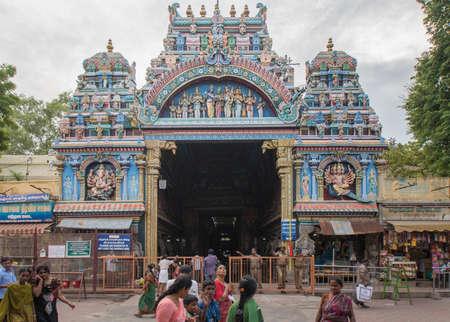 nagara: Madurai, India - October 19, 2013: The entrance facade to the public market hall called Nagara Mandapam. Police and visitors in the photo. Vendor stalls on the side.
