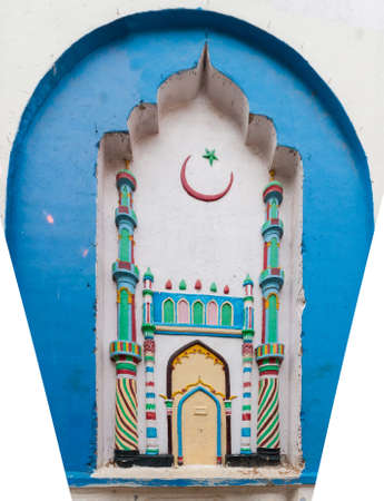 sunni: Madurai, India - October 21, 2013: Colorful niche painting and mural with image of mosque on the outer wall of Kajimar Mosque. Pastels over blue and white.