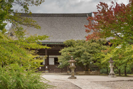philosophic: Kyoto, Japan - September 15, 2016: The main shrine of the Shinnyo-do Buddhist Temple dominates the temple grounds and sits among colorful trees. Editorial