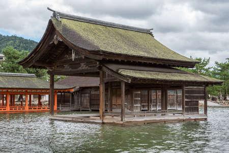 Hiroshima, Japan - September 20, 2016: Non Painted open hall of itsukushima Shinto Shrine on Miyajima Island built barely above sea level.