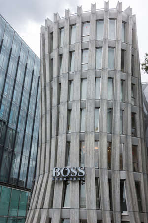upscale: Tokyo, Japan - September 28, 2016: The iconic Hugo Boss store stands along the main road in the upscale neighborhood of Jingumae. Concrete and glass.