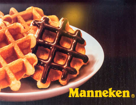 Tokyo, Japan - September 29, 2016: Poster at the restaurant-chain Manneken selling only Belgian Waffles. Colorful photo of such delicacies.