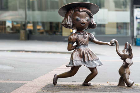 Auckland, New Zealand - March 1, 2017: Bronze statue of dancing girl with elephant, named Twist by the artist Tanja Jade McMillan. Misery is another name. On Pitt Street.
