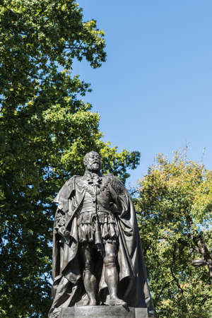 Hobart, Australia - March 19. 2017: Tasmania. Closeup of bronze statue of King Edward VII shows him looking proudly and defiant. Green park background and blue sky.