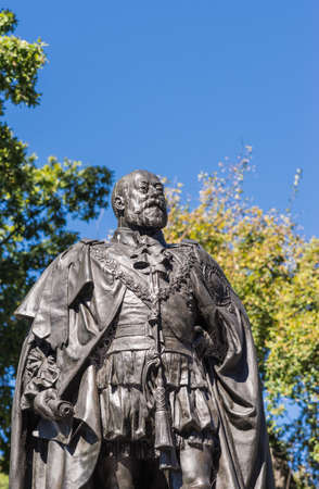 Hobart, Australia - March 19. 2017: Tasmania. Bust of bronze statue of King Edward VII shows him looking proudly and defiant. Green park background and blue sky.